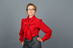 Woman in red blouse and glasses stock image