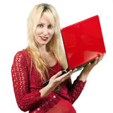 woman in  red blouse  with the red laptop Stock Image