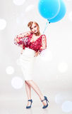 Woman in red blouse and white skirt Stock Images