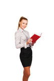 Woman with red book in hands standing Stock Photo
