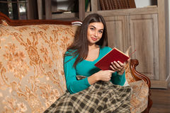 Woman with red book Stock Photo