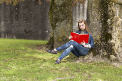 Woman with red book 2 Royalty Free Stock Images