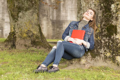 Woman with red book 5 Stock Photos