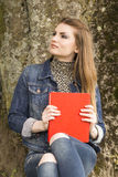 woman with red book Royalty Free Stock Photo