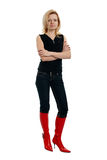Woman in red boots Stock Photography