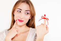 Woman red bow on finger Royalty Free Stock Images