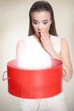 Woman with red box. She is surprise Royalty Free Stock Photo