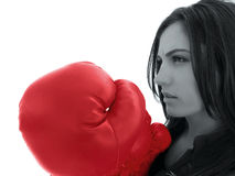 Woman with red boxing glove. Black and white side portrait of attractive young woman with large red boxing glove, isolated on white background with copy space stock image