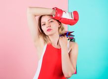 Woman red boxing glove hold bunch shopping bags blue pink background. Tips to shop sales. Buy everything you want. Girl. Tired with shopping. Fight for personal stock image