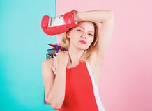 Woman red boxing glove hold bunch shopping bags blue pink background. Tips to shop sales. Buy everything you want. Girl. Tired with shopping. Fight for personal stock images