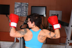 Woman in red boxing gloves Stock Images