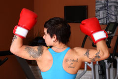 Woman in red boxing gloves Royalty Free Stock Photo