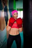 Woman red boxing gloves Royalty Free Stock Photos