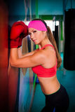 Woman red boxing gloves Royalty Free Stock Photography