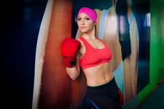 Woman red boxing gloves Royalty Free Stock Photo