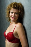 Woman in red brassiere closeup Stock Photography