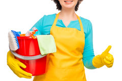 Woman with a red bucket in an apron and gloves Royalty Free Stock Images
