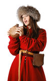 Woman in the red caftan with leather flask Stock Photos