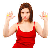 Woman in red with candy in open hand Royalty Free Stock Photo
