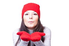 Woman in red cap blows Royalty Free Stock Photos