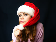 Woman in a red cap on darkly dark blue background Royalty Free Stock Photography