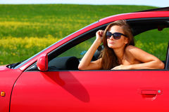 Woman in red car Royalty Free Stock Photography