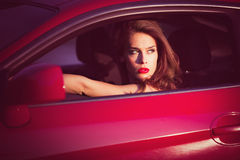 Woman in red car Royalty Free Stock Photo
