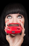 Woman with a red car Stock Image