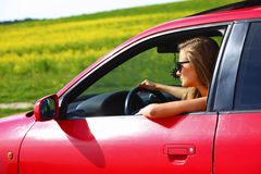 Woman in red car Stock Photography