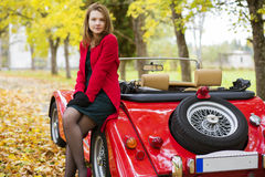 Woman in red and car at park Royalty Free Stock Images