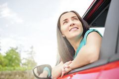 Woman in red car. Stock Photos