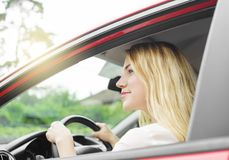 Woman in red car Stock Image