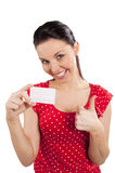 Woman in red with card smiling Royalty Free Stock Photos