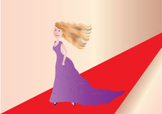 Woman on red carpet. Beautiful woman on red carpet in windy weather Stock Photo