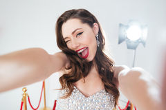 Woman on red carpet making selfie photo Royalty Free Stock Images