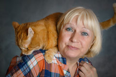 Woman with red cat. Stock Images