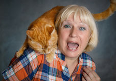 Woman with red cat. Stock Image