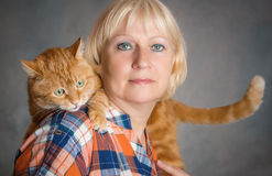 Woman with red cat. Royalty Free Stock Image