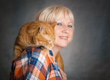Woman with red cat. Royalty Free Stock Photos