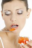 Woman with red caviar Stock Images