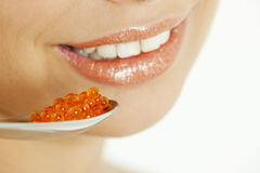 Woman with red caviar Royalty Free Stock Photos