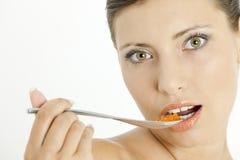 Woman with red caviar Stock Photos