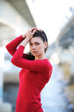 Woman in red. The charming woman in a red dress Stock Photography
