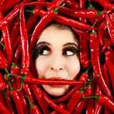 Woman and red chili pepper Stock Photos