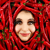 Woman and red chili pepper Royalty Free Stock Image