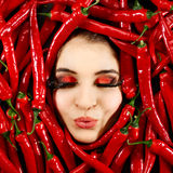 Woman and red chili pepper Royalty Free Stock Images