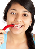 Woman with red chili pepper Royalty Free Stock Photos