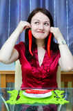 Woman with red chili peppers Stock Photos
