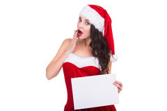 Woman in red christmas dress and hat holding a Royalty Free Stock Photo