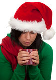 Woman in red Christmas hat with cup Stock Image